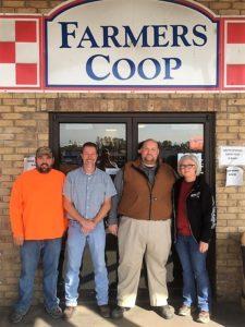 Farmer's Coop exterior with bulk feed team