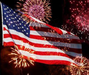 July 4th fireworks in front of American flag