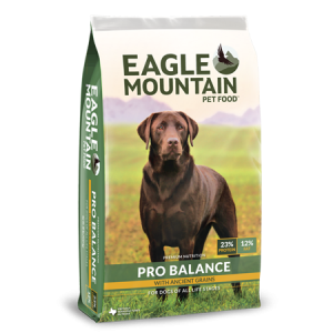Eagle Mountain Pro Balance Dry Dog Food. Dog food bag with large brown dog in green field.