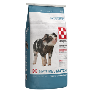 Purina Nature's Match Starter-Grower. Blue and white 50-lb feedbag. Feed for swine.